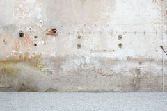 Weathered wall with gravel, stone chippings floor. Background royalty free stock photos
