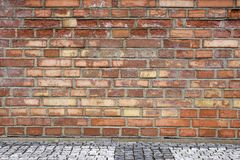 Red brick wall with pavement 6 Stock Photography
