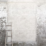Weathered wall with a wooden ladder Stock Photo