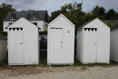 Weathered white beach huts Stock Image