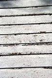 Weathered white painted boards. With peeling and crackled paint Stock Images