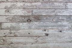 Weathered white wood barn siding background. Old weathered vintage rough peeling white painted wood barn siding background stock image