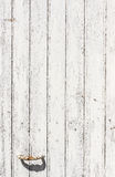 Weathered white wooden door with paint chipped and peeling. Stock Photography