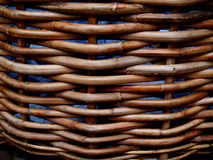 Weathered Wicker Basket. Holding blue towels beside a hotel pool Stock Image
