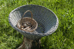 Weathered wicker laundry baskets with wooden laundry pegs Royalty Free Stock Photo