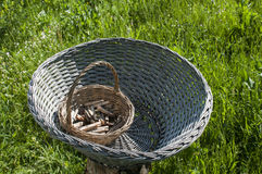 Weathered wicker laundry baskets with wooden laundry pegs Stock Photography
