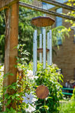 Weathered wind chime in the shade Stock Images