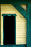 Weathered Window 1. A detailed close up of a weathered window on a painted wooden house or structure royalty free stock images
