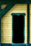 Weathered Window 2. A detailed close up of a weathered window on a painted wooden house or structure stock photography