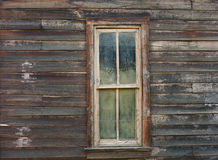Weathered window on old west building Royalty Free Stock Photography