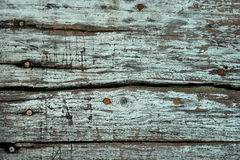 Weathered wood. This is a textured background shot of weathered wood with some nail head Royalty Free Stock Image