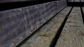 Weathered wood bench. Old weathered wood park bench Stock Image