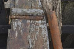 Weathered wood, corroded metal and fishing net Royalty Free Stock Images