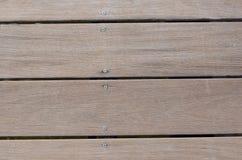 Weathered wood dock closeup with screws Stock Photo