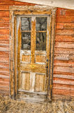 Weathered Wood and Glass Door Stock Photography