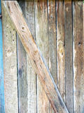 Weathered wood grain door. Weathered wood grain background pattern of boards Royalty Free Stock Images