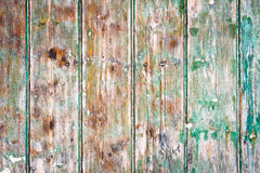 Weathered wood. Green painted wood which is weathered and discoloured Stock Images
