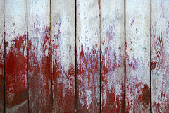 Weathered wood planks half painted in red and white color Stock Photography