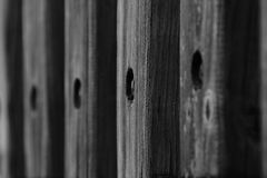 Weathered wood railing. Weathered wooden railing with texture royalty free stock photo