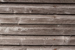 Weathered Wood Siding. Weathered and graying wood siding with rusty nail heads Stock Images