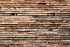 Weathered Wood Siding. Aged rich textured distant view of weathered wooden boards siding stock photos