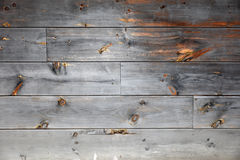 Weathered Wood Siding. A closeup of aged rich textured weathered wooden boards siding Stock Image