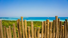 A weathered wood stick fence with breat taking beautiful blue sea landscape stock photos