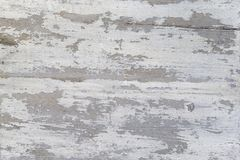 A Weathered wood texture with peeling white paint. Abstract grunge background. Stock Photo