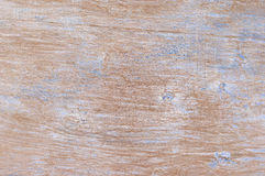 Weathered wood texture. Shabby weathered wood texture as background. Brown wood with remains of blue paint and scratches Royalty Free Stock Photography