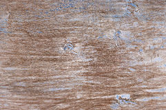 Weathered wood texture. Shabby weathered wood texture as background. Brown wood with remains of blue paint and scratches Stock Photo