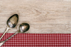 Weathered wood with two silver spoons Stock Photo