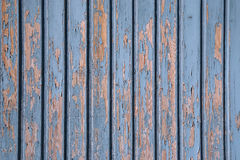 Weathered wooden background. Weathered wooden boards background with blue peeling paint Stock Image