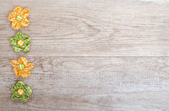 Wooden board with flowers Stock Photography