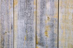 Weathered wooden board texture with remnants of yellow paint. royalty free stock images