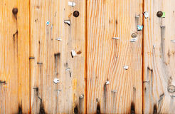 Weathered wooden boarding with scraps of notices Stock Photos
