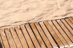 Weathered wooden boardwalk on sand Royalty Free Stock Photos
