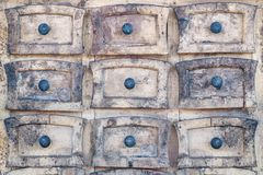 Weathered wooden cabinet with small drawers Stock Photography