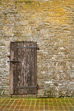 Weathered wooden door. In an ancient stone tower Stock Photo