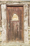 Weathered wooden door entrance grunge dirty Stock Image