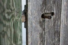 Weathered Wooden Door 2. Latch on weathered wooden door Royalty Free Stock Image