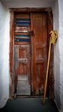 Weathered wooden door. And mop royalty free stock photos