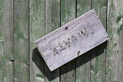 Weathered wooden door with almost vanished sign 'Private' Royalty Free Stock Images