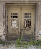 Weathered Wooden Doors on Abandoned Building Royalty Free Stock Image