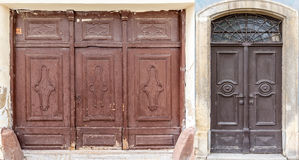 Weathered wooden doors. Photo collage of 2 weathered wooden doors Stock Photos