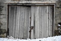 Weathered wooden doorway of an old concrete shed Stock Image