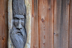 Weathered wooden face carving Royalty Free Stock Photos