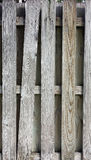 Weathered wooden fence with leaning slat and contrasting patterns Stock Photos