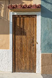 Weathered wooden front door of a spanish house Royalty Free Stock Photos