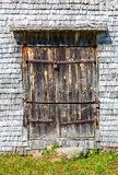 Weathered wooden gate of ancient church stock photo