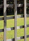 Weathered wooden lattice. In a garden stock images